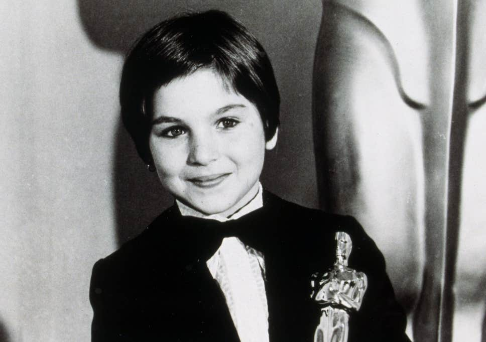 Tatum O'Neal with her Academy Award in 1974.